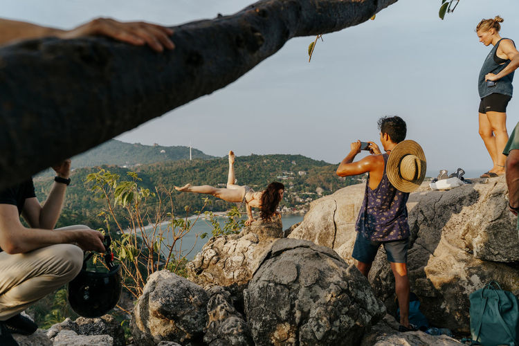 Tourists taking pictures on top of John Suwan Viewpoint in Koh Tao, Thailand Group Of People Rock Leisure Activity Lifestyles Real People Nature Rock - Object Solid Men People Full Length Sitting Adult Casual Clothing Women Mountain Water Friendship Togetherness Day Outdoors Instagrammers Influencer Photography Photographer Photography Themes Photographing Sightseeing Viewpoint Tourists Tourism
