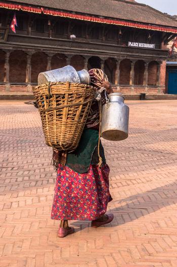 Woman carrying wicker basket