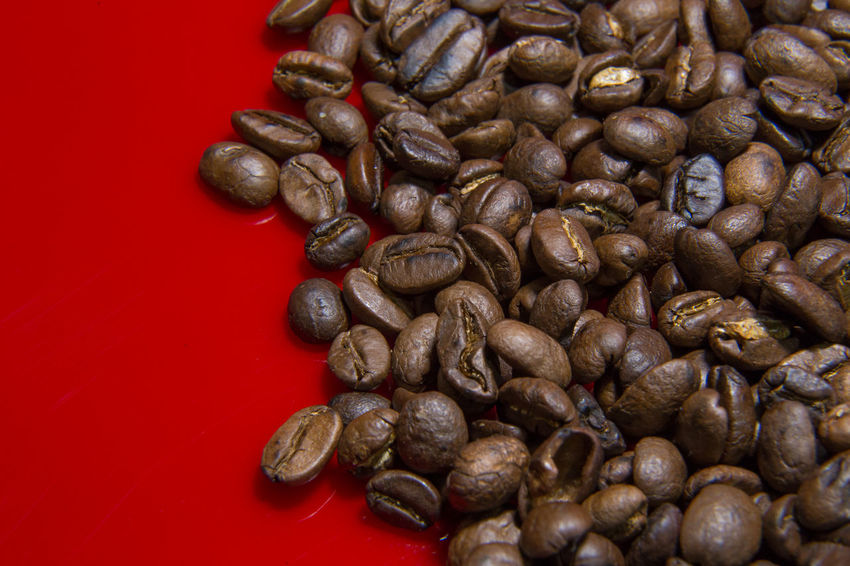 The Roasted Coffee Beans red background macro close up image for coffee background. Roasted Coffee Beans Coffee Beans Baker Coffee Beans Roasted Abundance Brown Close-up Coffee Bean Coffee Beans Coffee Beans For Sale Coffee Beans Roaster Food Food And Drink Freshness Healthy Eating Indoors  Large Group Of Objects No People Raw Coffee Bean Roasted Roasted Coffee Roasted Coffee Bean