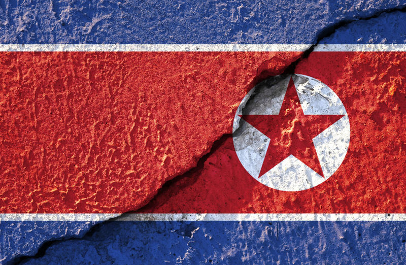 Closeup crack of North Korea flag for background and texture. Abstract Alliance America ASIA Background Banner Communism Competition Conference Conflict Continent Country Design Economy Election Flag Freedom Global Government Grunge International Kim  Korea Korean Meeting Military Nation National North North Korea North Korean Nuclear Patriot Peace Politics Power Pyongyang Republic Sign States Symbol Symbolic  Textured  United USA Vs Wallpaper War Waving World