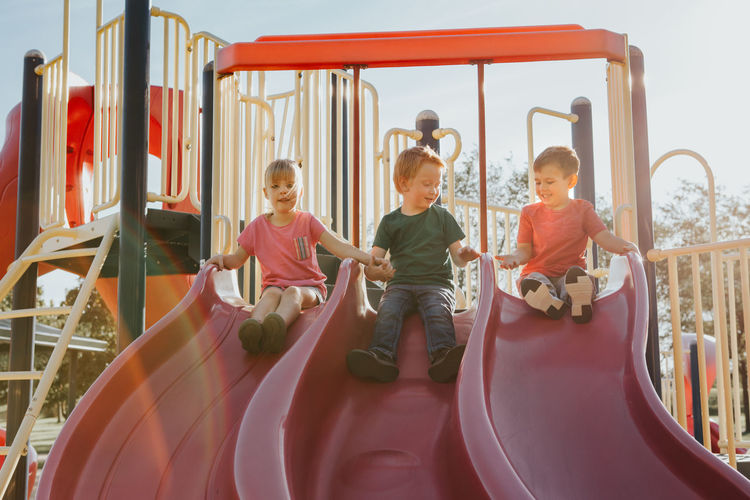 Children playing on slide at playground