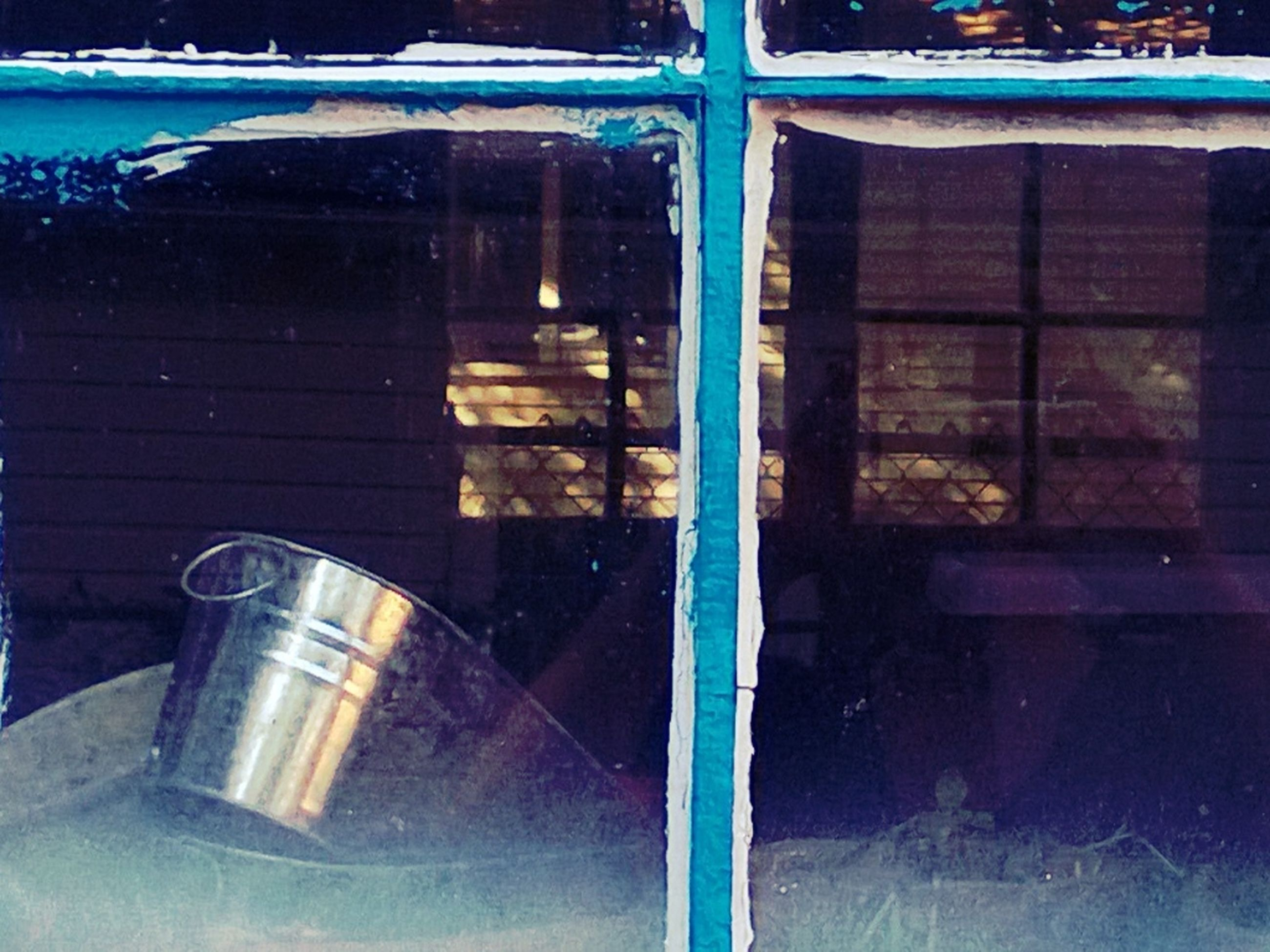 glass - material, window, blue, transparent, indoors, reflection, built structure, closed, abandoned, door, no people, metal, old, architecture, house, wall - building feature, glass, building exterior, damaged, close-up