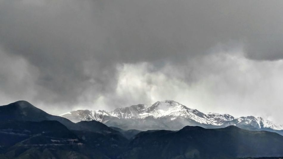"""Giants everywhere reared their splintered crests."" - Isabella Bird Colorado Springs, Colorado Storms Mountain Range Rocky Mountains Snowcapped Mountain Greyscale First Eyeem Photo"
