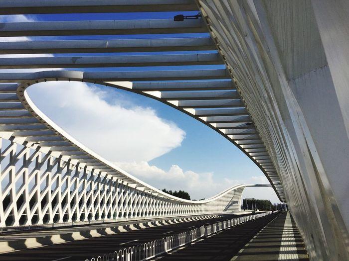 View of modern bridge against cloudy sky