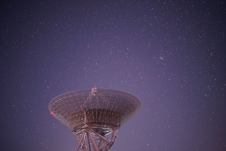 Low Angle View Satellite Dishes Against Star Field