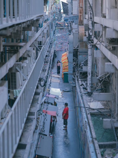 Industry Occupation High Angle View Architecture Working One Person Real People Built Structure Rear View Men Day Protection Walking Standing Transportation Full Length Clothing Building Exterior