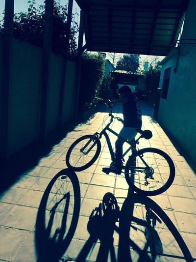 Bike Shadow Bicycle Transportation Cycling Land Vehicle Mode Of Transport Real People Riding Full Length Built Structure One Person Lifestyles Helmet Day Headwear Outdoors Shadow Sunlight Childhood Architecture Building Exterior