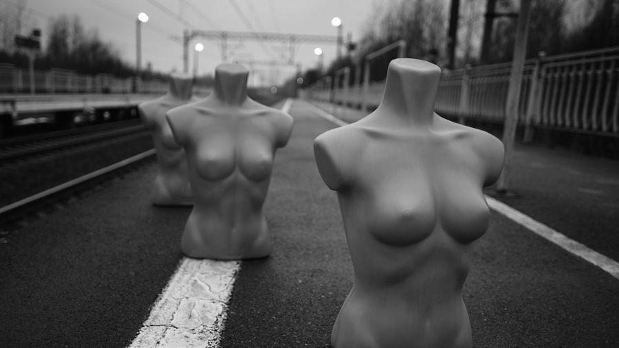 Close-up of mannequins on railroad platform
