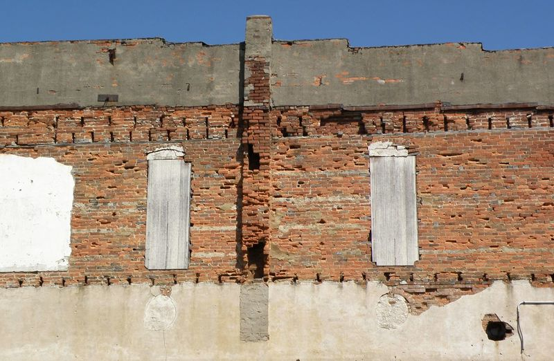 Side of an old brick building in Linden, Indiana Architecture Blue Brick Brick Wall Building Exterior Built Structure Damaged Day Deterioration No People Obsolete Outdoors Peeling Off Run-down Sunny Weathered
