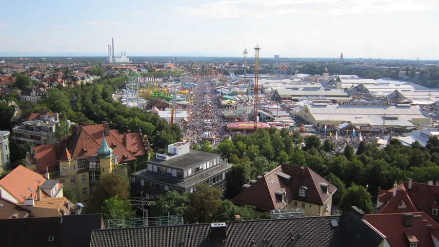 High angle view of oktoberfest on city street against sky