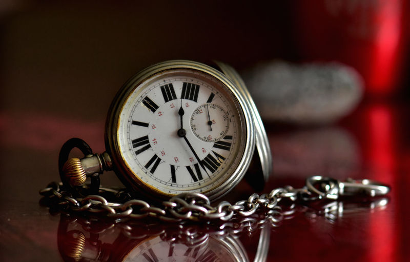 Time Clock Indoors  Pocket Watch Close-up Watch Antique Instrument Of Time Focus On Foreground No People Retro Styled Metal Chain Number Selective Focus Old Table Still Life Wood - Material Clock Face Luxury Personal Accessory Minute Hand Ornate Floral Pattern