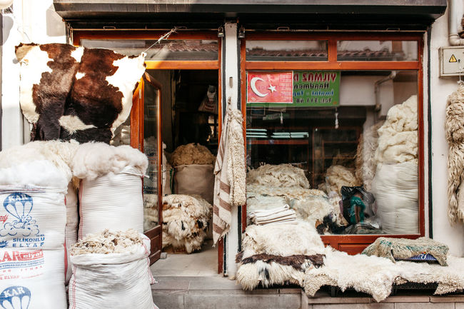 Pelts Ankara Architecture Building Exterior Built Structure Communication Day For Sale House Indoors  Market Market Stall Men Non-western Script Retail  Shop Small Business Stack Store Text Textiles Turkey Wool