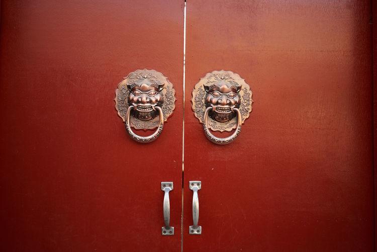 Close-up of metal door knockers