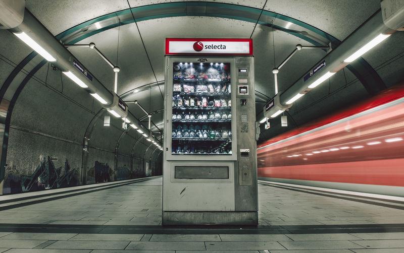 Low angle view of illuminated subway station