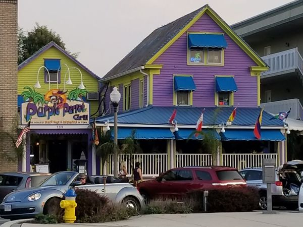 Colorful Cuisine on the Beach Restaurants Lavendar Purple Yellow Drinks Cocktails Contemporary Architecture Colorful Beach Photography The Beach  Advertisement Summer Bright Colors Fun Funtimes Friends Convertible Car Commercial Commercial Photography Blue Outdoor Eating Rehoboth Beach Contemporary Design Food And Drink Multi Colored Sky Architecture Building Exterior Exterior Vehicle
