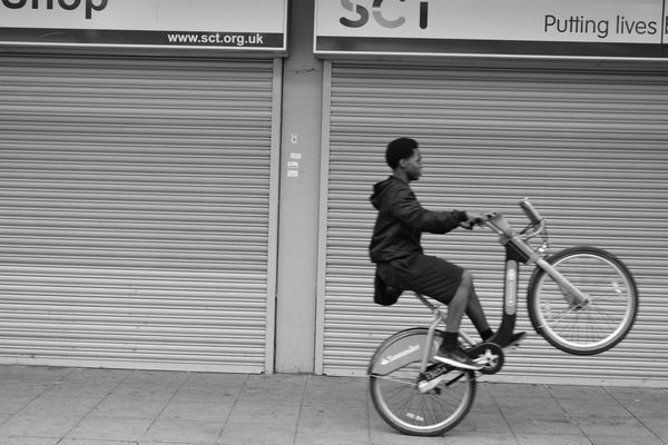 EAST LONDON VIBES Architecture Bike Blur Casual Clothing City City Life Cyling Day Full Length Leaning Leisure Activity Lifestyles Mode Of Transport Outdoors Wheelie Welcome To Black