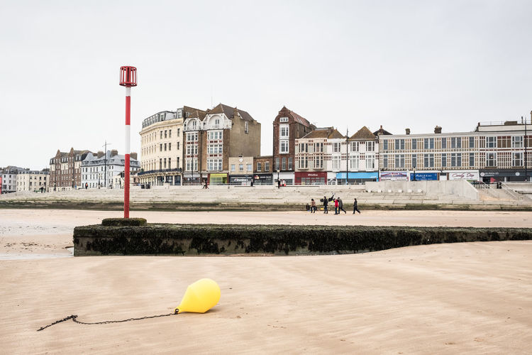 Beach & View of the Seafront, Margate, Kent, UK Architecture Building Exterior Sky Day Incidental People Real People Water Outdoors Travel Destinations People Margate Kent Beach Sands Seafront Waterfront Seaside Buoy Coast Coastline