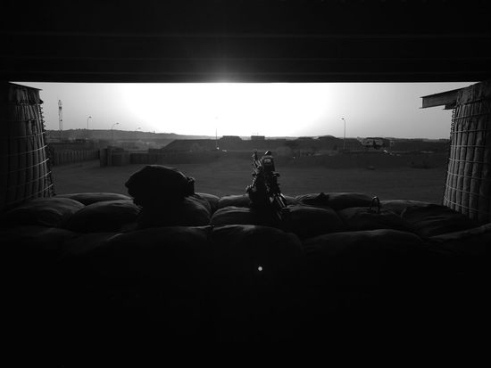 Front gate security. Army Machinegun Minimi B&w Sunset