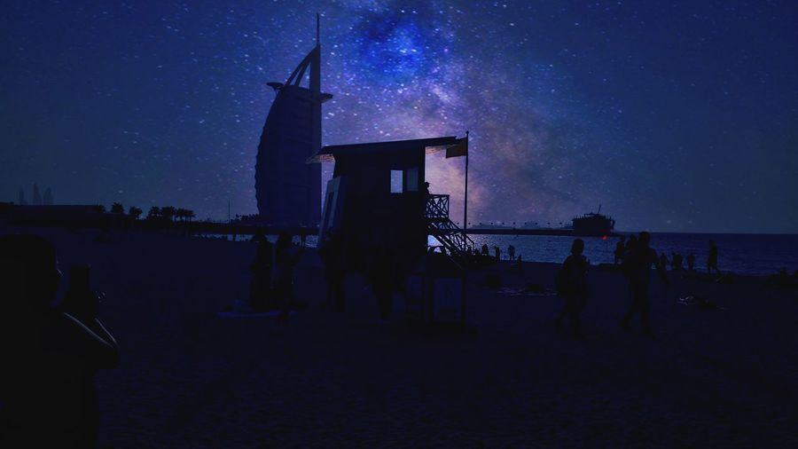 EyeEmNewHere Night Star - Space Burjalarabdubai Outdoors Architecture Nature Travel Destinations Astronomy Galaxy Sea Beach Sky