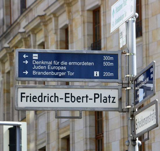 A Taste Of Berlin Berlin Photography Airport Architecture Arrow Symbol Built Structure Close-up Communication Day Democracy Direction Guidance Information Sign No People Outdoors Road Sign Street Directional Sign Street Name Sign Street Name Signs Text Western Script #FREIHEITBERLIN The Street Photographer - 2018 EyeEm Awards The Street Photographer - 2018 EyeEm Awards