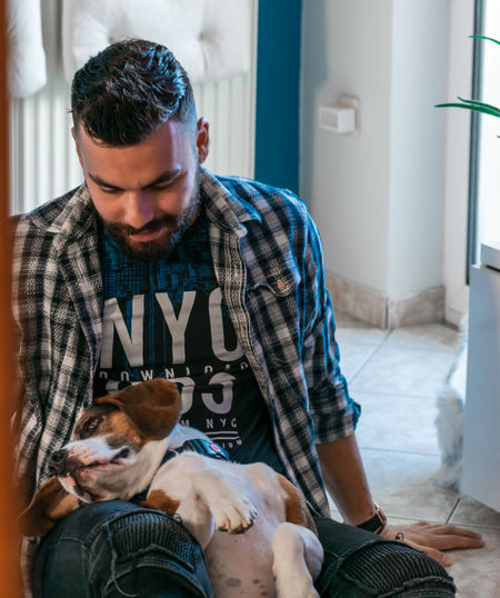 Man sitting with dog at home