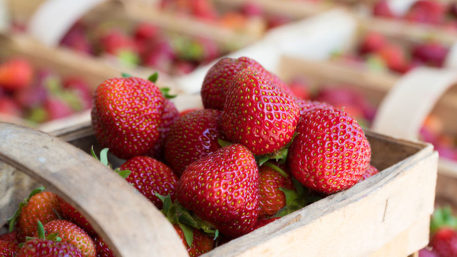 A backet of fresh ripe strawberries Close-up Day Focus On Foreground Food Food And Drink Freshness Fruit Healthy Eating Large Group Of Objects Market No People Outdoors Red Wood - Material