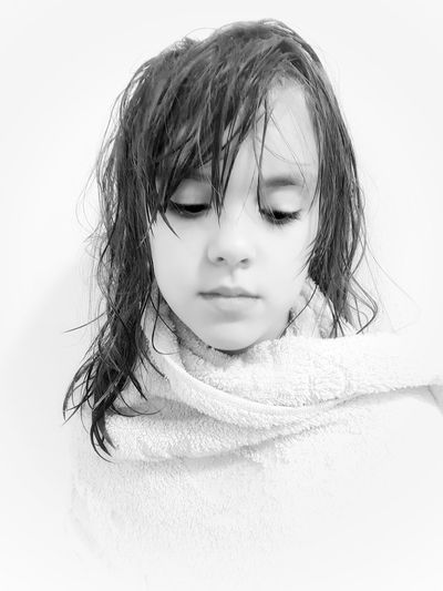 Close-up of girl against white background