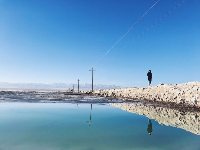 Shades Of Winter Salt Lake Mirror Water Nature Real People Clear Sky Reflection Blue Scenics Beauty In Nature One Person Standing Outdoors Landscape Winter