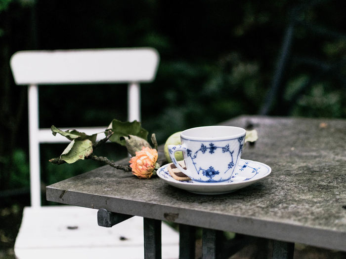 Close-up of coffee cup and fruits on table