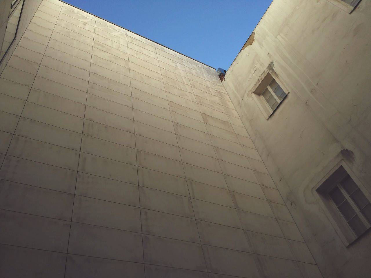 architecture, low angle view, built structure, building exterior, no people, day, clear sky, outdoors, sky