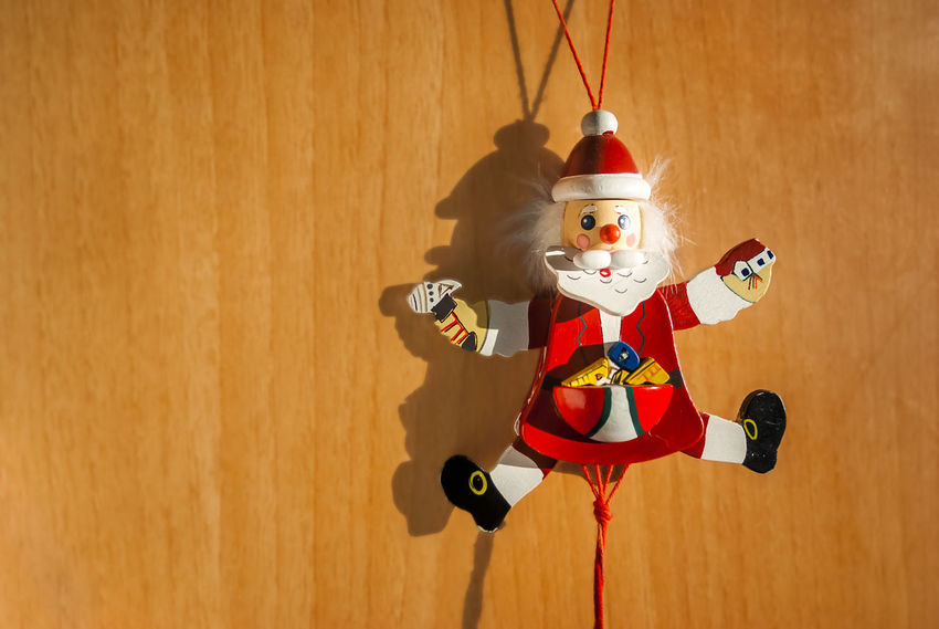 A small wooden Santa happy to breathe fresh air out of the box where they usually keep it the rest of the year Celebration Celebration Event Christmas Christmas Decoration Christmas Gift Christmas Lights Gifts Glad Greetings Happiness Happy New Year Happy Time Holidays Hopeful Indoors  Jumping No People Ornamental Regards Santa Claus Sonyalpha Still Life Toy Tradition Wood Dolls