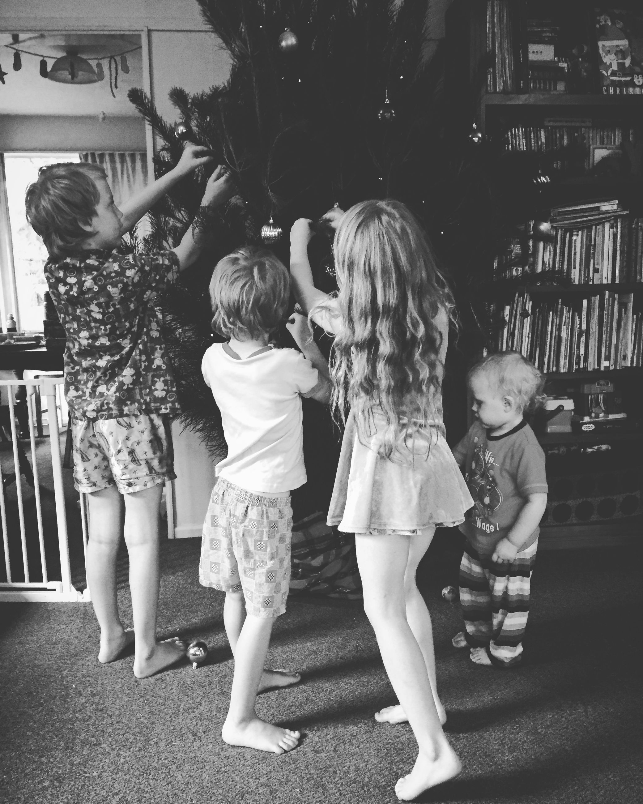 lifestyles, togetherness, full length, casual clothing, childhood, bonding, love, leisure activity, girls, elementary age, rear view, boys, family, street, family with one child, innocence, sibling, person