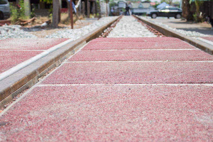 On the Road Day Diminishing Perspective Direction Focus On Foreground High Angle View In A Row Nature No People Outdoors Parallel Rail Transportation Railroad Track Red Running Track Selective Focus Sport Surface Level The Way Forward Track Track And Field