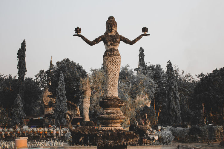 Statue of temple against sky