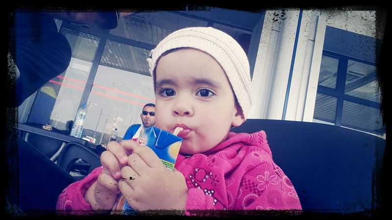 Her first juice box...Transitional Moments