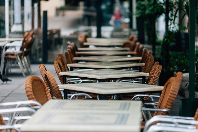 Chairs and tables arranged at outdoor restaurant
