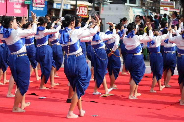 Women dancing on footpath