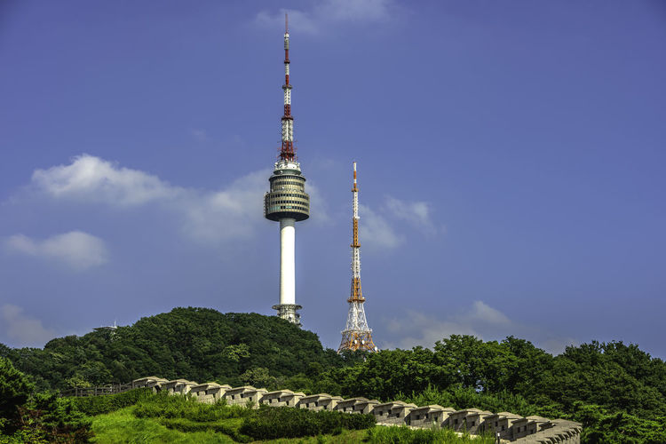 Seoul tower,Namsan tower in korea Architecture Building Building Exterior Built Structure Cloud - Sky Communication Day Global Communications Low Angle View Nature No People Outdoors Plant Sky Spire  Tall - High Tower Travel Travel Destinations Tree