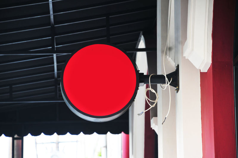 Low angle view of red lanterns hanging on wall