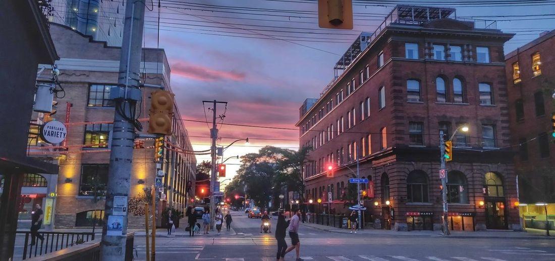 City street amidst buildings at dusk