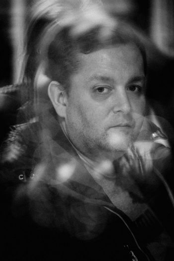 Close-up portrait of man smoking
