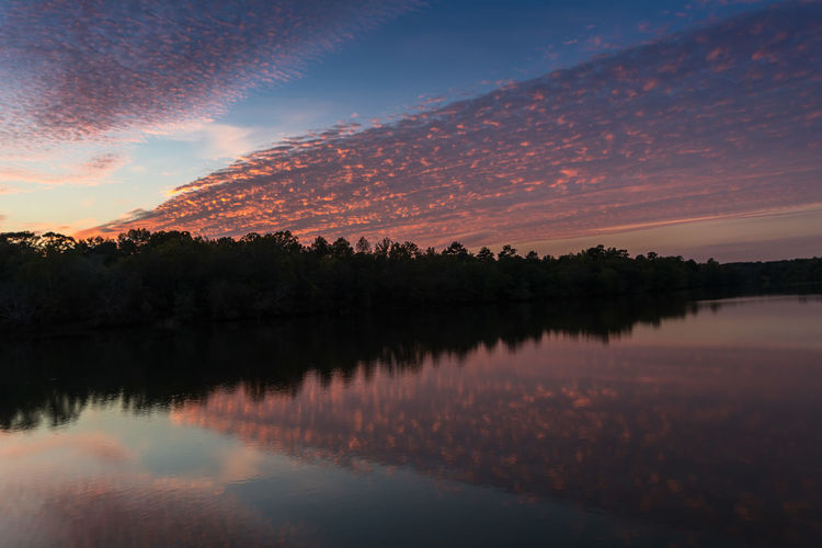 Sunset over the Ocmulgee River Beauty In Nature Day Idyllic Lake Mountain Nature No People Outdoors Reflection Scenics Sky Sunset Tranquil Scene Tranquility Tree Water Waterfront