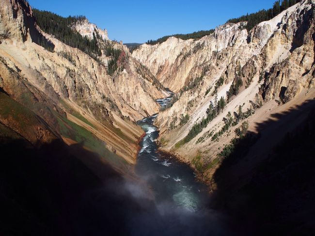 Canyon Yellowstone National Park Hydroelectric Power Water Fuel And Power Generation River Nature Mountain Scenics Day Beauty In Nature No People Outdoors Alternative Energy Sunlight Physical Geography Clear Sky Mountain Range Waterfall