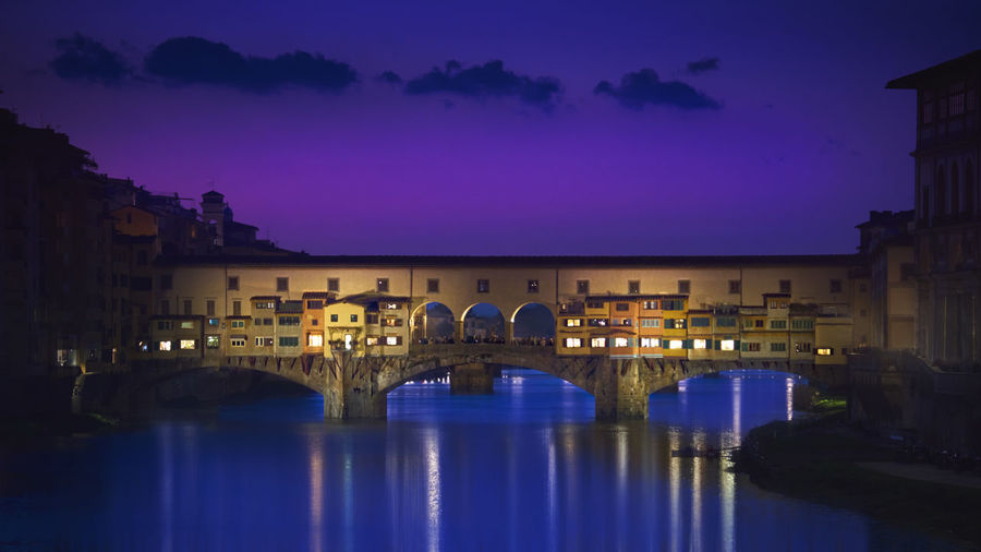 The Old Bridge Arch Arch Bridge Architecture Bridge - Man Made Structure Building Exterior Built Structure City City Life Cityscape Connection Dusk Florence Illuminated Italy Night No People Outdoors Ponte Vecchio Reflection River Sky Sunset Travel Destinations Water Waterfront
