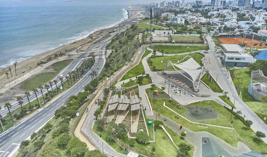 High angle view of road by sea and buildings in city