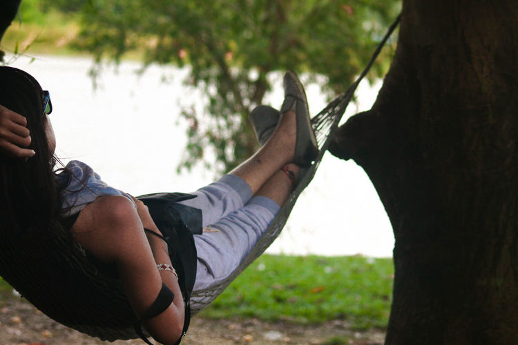 Lying In A Hammock Relaxation Lazy Day Outdoors Leisure Activity Idyllic One Person Nature Vacations Young Adult Close-up Peaceful Nap Napping On A Hammock Hammock Time Hammock