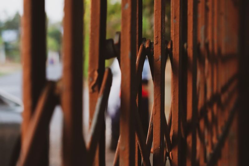 The wall on your mind. Selective Focus Close-up No People In A Row Wood - Material Focus On Foreground Day Barrier Safety Metal Large Group Of Objects Brown Sunlight Security