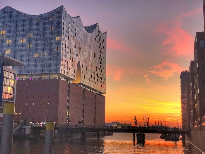 Elbphilharmonie Sunset Water Sky Architecture Building Exterior Built Structure Cloud - Sky Nature Orange Color Building Sea City Waterfront Incidental People Transportation Outdoors Beauty In Nature Reflection