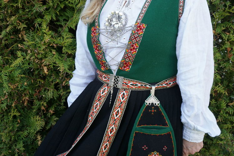 Midsection of woman wearing traditional clothing