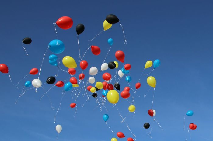 Multi Colored Balloon Flying Party - Social Event Helium Balloon Celebration Social Issues Mid-air Blue Blurred Motion